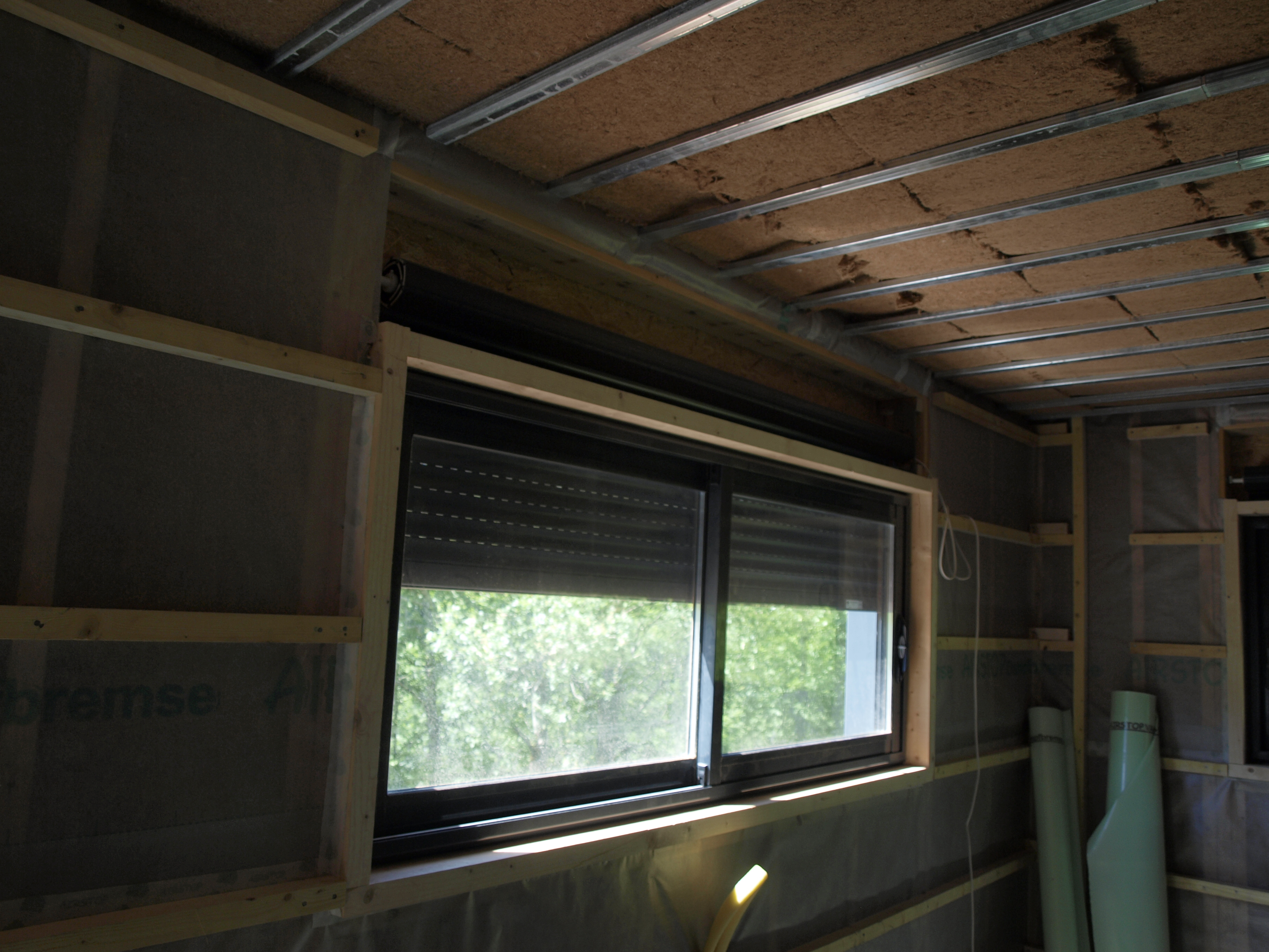 Réalisations maisons ossature bois - Menuiserie avec volet roulant